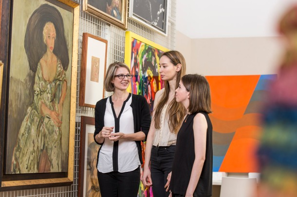 Curator Samantha Littley with students in the Collection Study Room